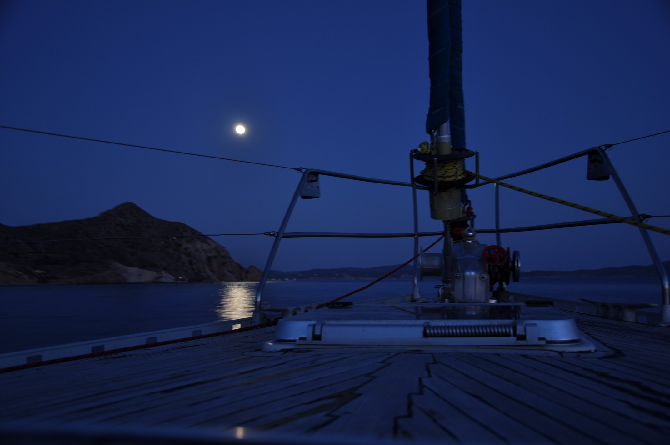 Romantic dinner on board a yacht under the nightsky and moon